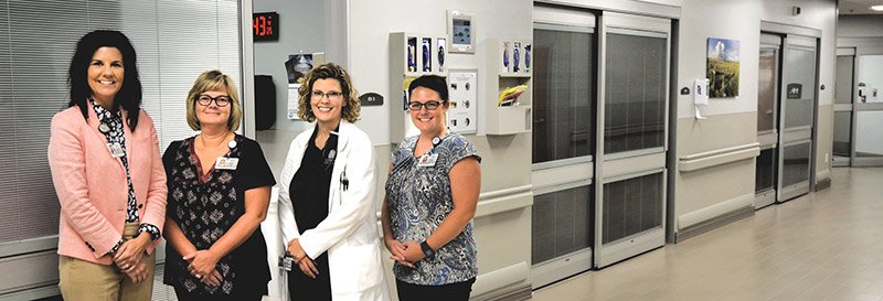 Newman Regional Health team members (L to R) Cathy Pimple, Chief Quality and Compliance Officer; Nina Topper, Clinical Analyst; Dr. Alana Longwell, Hospitalist and Inpatient Rehabilitation Medical Director; and Aubrey Arnold, Care Manager.